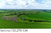Купить «Beautiful rural landscape shot from above. Russia», видеоролик № 33279134, снято 29 февраля 2020 г. (c) Володина Ольга / Фотобанк Лори