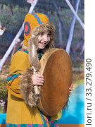 Купить «Girl dancing with tambourine in national clothing indigenous inhabitants Kamchatka. Celebration Koryak national ritual holiday Day of Seal - Hololo. Kamchatka Peninsula, Russia», фото № 33279490, снято 4 ноября 2018 г. (c) А. А. Пирагис / Фотобанк Лори