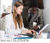 Купить «Focused coworkers working together», фото № 33279874, снято 25 мая 2020 г. (c) Яков Филимонов / Фотобанк Лори