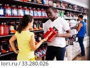 Купить «Woman choosing sports supplements in store», фото № 33280026, снято 7 апреля 2020 г. (c) Яков Филимонов / Фотобанк Лори