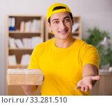 Купить «Delivery man delivering parcel box», фото № 33281510, снято 1 ноября 2016 г. (c) Elnur / Фотобанк Лори