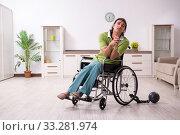 Купить «Young male invalid in wheel-chair suffering at home», фото № 33281974, снято 23 июля 2019 г. (c) Elnur / Фотобанк Лори