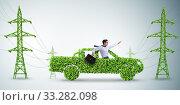 Купить «Electric car and green energy concept», фото № 33282098, снято 9 июля 2020 г. (c) Elnur / Фотобанк Лори