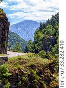 Купить «Serpentine mountain road. View of the Goderdzi pass. Caucasus Mountains. Georgia», фото № 33282410, снято 13 июля 2019 г. (c) Евгений Ткачёв / Фотобанк Лори
