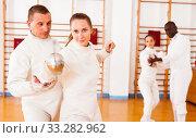 Купить «Woman practicing new movements with trainer at fencing room», фото № 33282962, снято 11 июля 2018 г. (c) Яков Филимонов / Фотобанк Лори