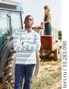 Male worker posing near tractor. Стоковое фото, фотограф Яков Филимонов / Фотобанк Лори