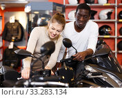 Купить «couple in motorcycle shop choosing new vehicle», фото № 33283134, снято 16 января 2019 г. (c) Яков Филимонов / Фотобанк Лори