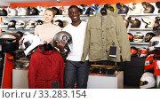 Couple holding purchased riding gear. Стоковое фото, фотограф Яков Филимонов / Фотобанк Лори