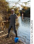 Portrait of enthusiastic African fisherman. Стоковое фото, фотограф Яков Филимонов / Фотобанк Лори