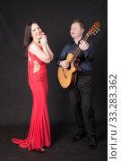 Купить «Singer and accompanist», фото № 33283362, снято 18 января 2014 г. (c) Argument / Фотобанк Лори
