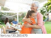 Купить «Family eating outside together in summer», фото № 33283670, снято 17 октября 2019 г. (c) Wavebreak Media / Фотобанк Лори