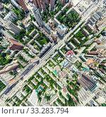 Купить «Aerial city view with crossroads and roads, houses, buildings, parks and parking lots. Sunny summer panoramic image», фото № 33283794, снято 29 марта 2020 г. (c) Александр Маркин / Фотобанк Лори