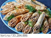 buckwheat crepe rolls with meat, veggies, top view. Стоковое фото, фотограф Oksana Zh / Фотобанк Лори