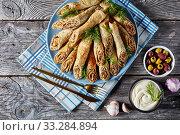 buckwheat crepe rolls with meat, veggies, flat lay. Стоковое фото, фотограф Oksana Zh / Фотобанк Лори