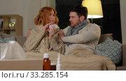Купить «sick young couple at home in evening», видеоролик № 33285154, снято 18 февраля 2020 г. (c) Syda Productions / Фотобанк Лори