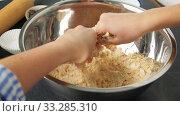 Купить «chef or baker making dough at bakery», видеоролик № 33285310, снято 15 февраля 2020 г. (c) Syda Productions / Фотобанк Лори