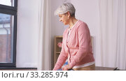 Купить «senior woman with vacuum cleaner cleaning at home», видеоролик № 33285974, снято 19 января 2020 г. (c) Syda Productions / Фотобанк Лори
