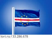 Flag of Cape Verde flying against a blue sky. Стоковое фото, фотограф Zoonar.com/Ruslan Gilmanshin / age Fotostock / Фотобанк Лори
