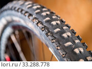 Купить «Mountain bike tire tread closeup at home workshop.», фото № 33288778, снято 3 апреля 2020 г. (c) easy Fotostock / Фотобанк Лори