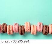 Macarons on turquoise, copy space top. Стоковое фото, фотограф Ольга Сергеева / Фотобанк Лори