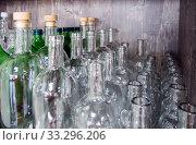 Купить «Стеклянная посуда для домашних алкогольных напитков», фото № 33296206, снято 14 августа 2019 г. (c) Вячеслав Палес / Фотобанк Лори