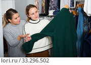 Купить «Women shopping in outerwear clothing boutique», фото № 33296502, снято 6 декабря 2018 г. (c) Яков Филимонов / Фотобанк Лори