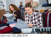 Купить «Women choosing warm coats in boutique», фото № 33296514, снято 6 декабря 2018 г. (c) Яков Филимонов / Фотобанк Лори