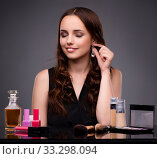Woman doing makeup on dark background. Стоковое фото, фотограф Elnur / Фотобанк Лори