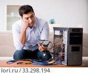 Купить «Frustrated man with broken pc computer», фото № 33298194, снято 8 декабря 2016 г. (c) Elnur / Фотобанк Лори