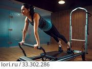 Slim woman in sportswear, pilates training. Стоковое фото, фотограф Tryapitsyn Sergiy / Фотобанк Лори