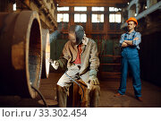 Welder works on factory, worker on background. Стоковое фото, фотограф Tryapitsyn Sergiy / Фотобанк Лори