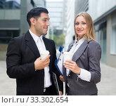 Portrait of couple who are standing with folder and coffee. Стоковое фото, фотограф Яков Филимонов / Фотобанк Лори