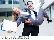 Boss is carry woman manager on hands because they are satisfied of successful contract. Стоковое фото, фотограф Яков Филимонов / Фотобанк Лори
