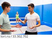 Купить «People preparing to trampoline training», фото № 33302702, снято 25 мая 2020 г. (c) Яков Филимонов / Фотобанк Лори