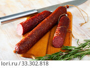 Купить «Russian dry smoked sausage with rosemary», фото № 33302818, снято 3 апреля 2020 г. (c) Яков Филимонов / Фотобанк Лори