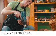 Купить «Pottery - master is drying a clay bowl with a construction hairdryer», видеоролик № 33303054, снято 5 апреля 2020 г. (c) Константин Шишкин / Фотобанк Лори