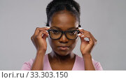 Купить «portrait of african american woman in glasses», видеоролик № 33303150, снято 8 февраля 2020 г. (c) Syda Productions / Фотобанк Лори
