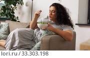 Купить «smiling young woman eating vegetable salad at home», видеоролик № 33303198, снято 24 февраля 2020 г. (c) Syda Productions / Фотобанк Лори