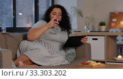 woman with tablet pc drinking red wine at home. Стоковое видео, видеограф Syda Productions / Фотобанк Лори