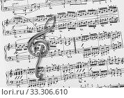 Купить «Treble clef on music sheet - musical art background», фото № 33306610, снято 31 мая 2020 г. (c) easy Fotostock / Фотобанк Лори