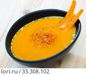Купить «Tasty carrot cream soup with carrot served at plate on table», фото № 33308102, снято 7 апреля 2020 г. (c) Яков Филимонов / Фотобанк Лори