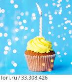Купить «birthday cupcake with one burning candle», фото № 33308426, снято 30 июня 2016 г. (c) Syda Productions / Фотобанк Лори