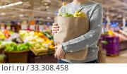 Купить «close up of woman with paper bag full of food», фото № 33308458, снято 3 мая 2019 г. (c) Syda Productions / Фотобанк Лори