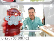 man taking juice from fridge at home kitchen. Стоковое фото, фотограф Syda Productions / Фотобанк Лори