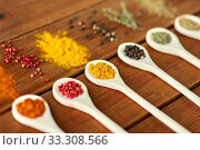 Купить «spoons with different spices on wooden table», фото № 33308566, снято 6 сентября 2018 г. (c) Syda Productions / Фотобанк Лори