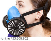 Close up view at woman head with protective mask handling hazardous chemicals. Side view, isolated on white background. Стоковое фото, фотограф Кекяляйнен Андрей / Фотобанк Лори