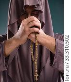 Купить «Monk in religious concept on gray background», фото № 33310502, снято 26 октября 2016 г. (c) Elnur / Фотобанк Лори