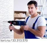Купить «Repairman working with drilling drill perforator», фото № 33313570, снято 9 декабря 2016 г. (c) Elnur / Фотобанк Лори