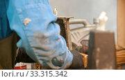 Купить «Concrete industry - man worker trying to connect two parts of one detail», видеоролик № 33315342, снято 8 апреля 2020 г. (c) Константин Шишкин / Фотобанк Лори