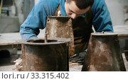 Купить «Concrete industry - man worker connecting two parts of one detail», видеоролик № 33315402, снято 5 июня 2020 г. (c) Константин Шишкин / Фотобанк Лори